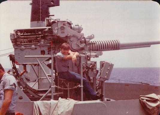 HM2-USS Plymouth Rock (LSD-29) Playing on a gun mount.